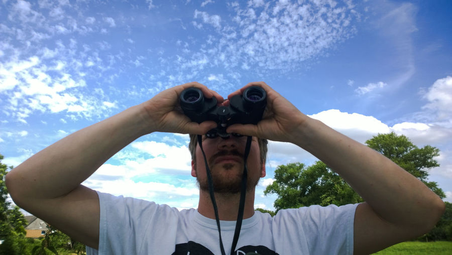 Binoculars Blue Casual Clothing Cloud Cloud - Sky Day Enjoyment Fun Leisure Activity Lifestyles Man Nature Outdoors Photographing Portrait Sky The OO Mission