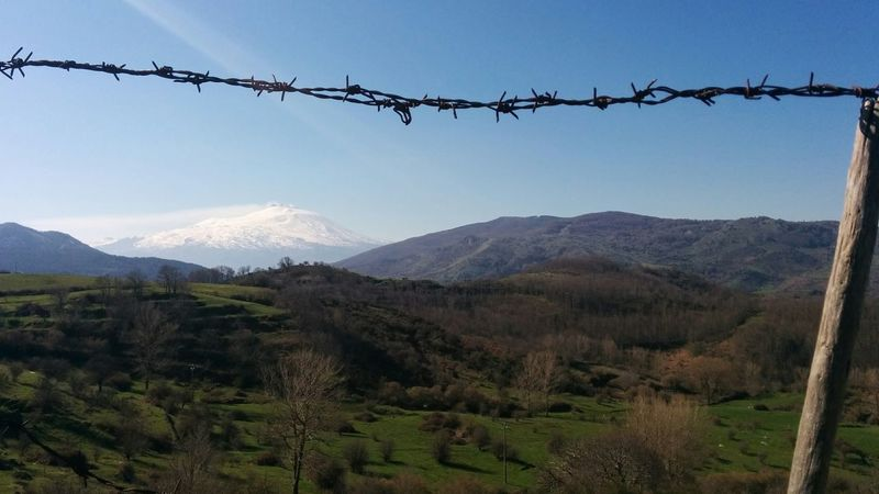A Muntagna incombe laggiù Barbed Wire Etna EyeEm Italy EyeEm Nature Lover Green And Blue Landscape_photography Mountain Non-urban Scene Perspective Sicily Volcano Showcase: July
