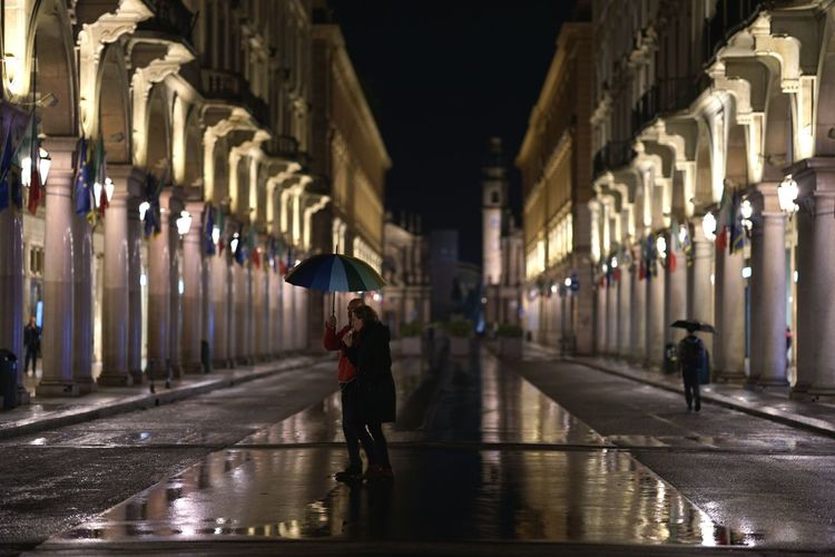 People at night in turin Historic Building Archway Passage Colonnade Architectural Column Umbrella Travel Architecture Rain Wet Flood City Streetphotography Mirkomacaritorino