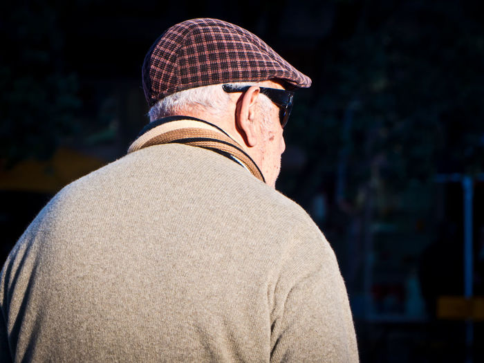 Rear view of man wearing hat while standing outdoors