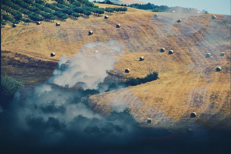 Double exposure high angle view of land through clouds, surrealism