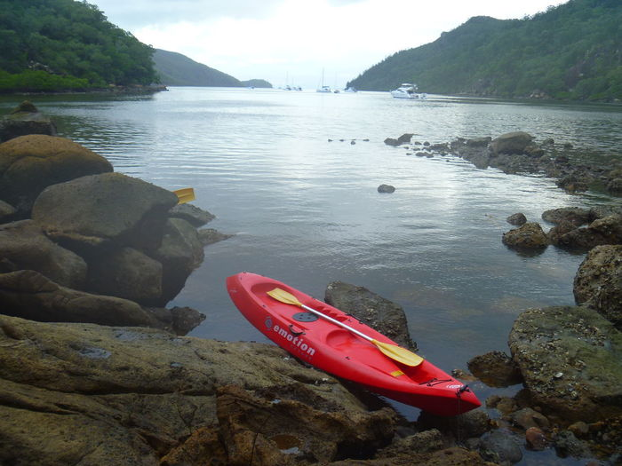 Kayak Kayaking In Nature Water Nautical Vessel Beach Tranquility Nature Tranquil Scene No People Sea Landscape Scenics Outdoors Mountain Kayak Beauty In Nature