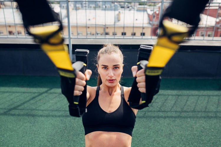Portrait of woman exercising in gym