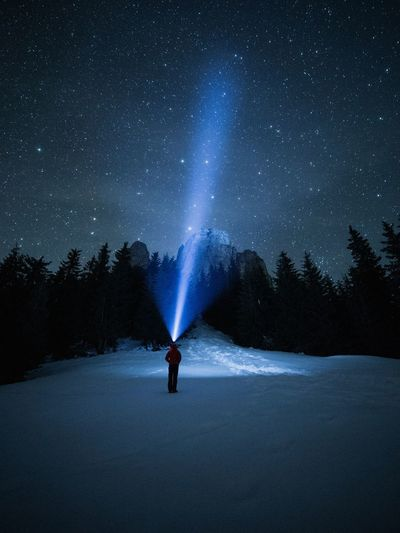 Night One Person Star - Space Tree Beauty In Nature Astronomy Snow Scenics - Nature Cold Temperature Space Sky Winter Nature Plant Real People Land Standing Leisure Activity Full Length Flashlight Milky Way person Headlamp Nightphotography Outdoors