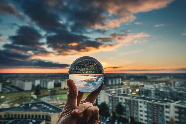Flip the horizon Human Hand Building Exterior Holding Cityscape City Cloud - Sky Travel Destinations Human Body Part Sky Sunset Built Structure Communication Architecture Outdoors Residential Building Close-up Urban Skyline Crystal Ball Glass Ball Crystal Ball Glass Upside Down Lithuania Panevėžys