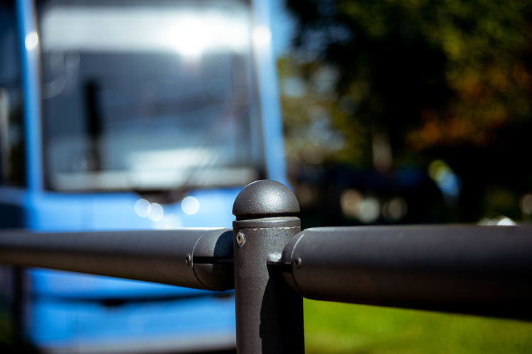 Close-up of metal railing against blurred background