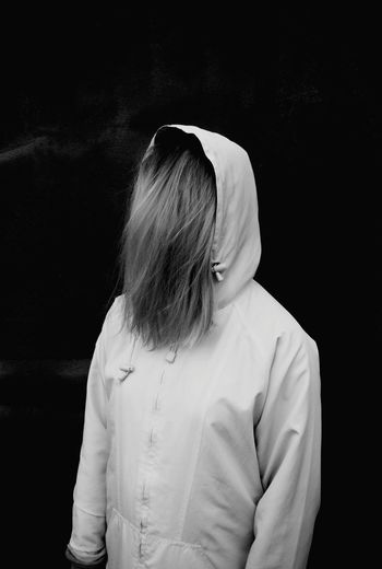 Woman wearing hooded shirt at night