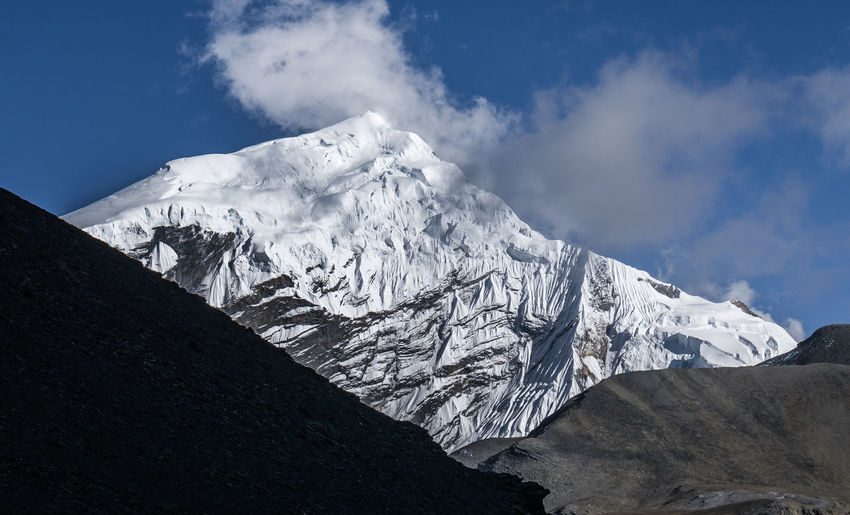 Shot of Chulu Central (6.584 m). Nepal Nepal Travel Mountain Sky Snow Cloud - Sky Scenics - Nature Beauty In Nature Landscape Environment Tranquil Scene Mountain Range Snowcapped Mountain White Color Ice Nature Mountain Peak Outdoors No People Iceberg Formation Hiking Trekking Travel Travel Destinations
