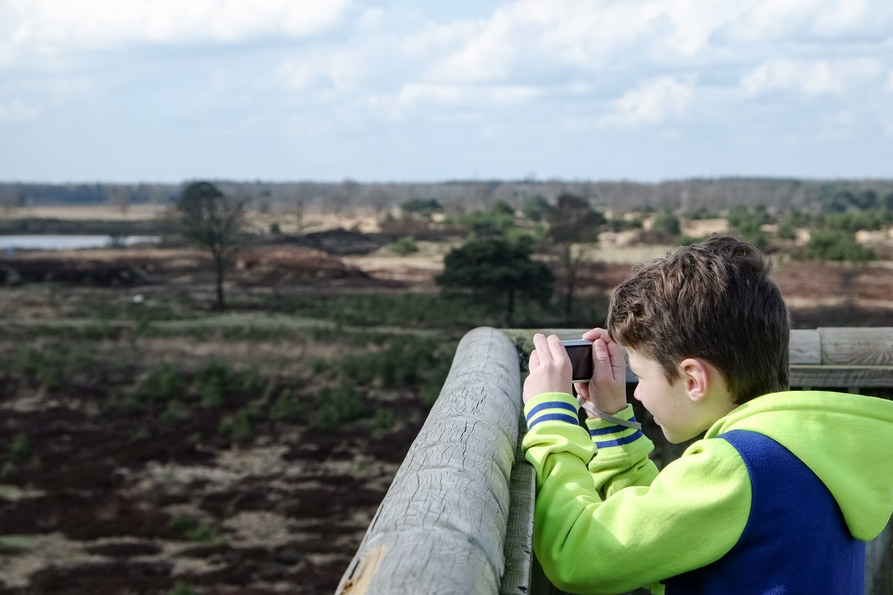 Side View Of Boy Photographing Landscape At Observation Point