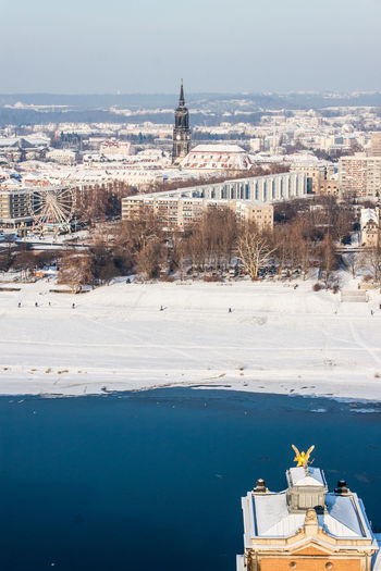 High angle view of cityscape by elbe river during winter