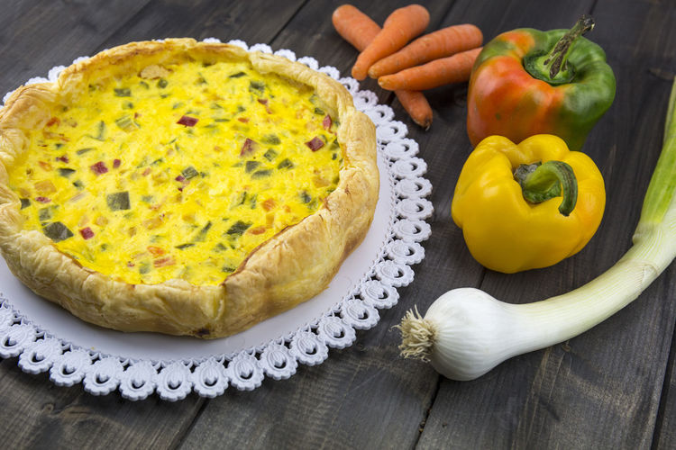 Yellow Tart With Vegetables On Table