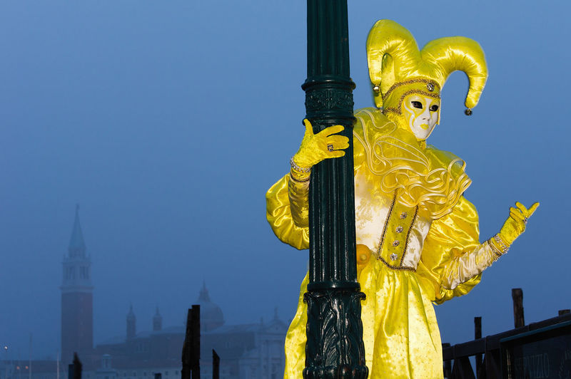 Carnival in Venice Canal Grande Carnival In Venice Architecture Building Exterior Built Structure Clear Sky Costume Day Gold Colored History Human Representation Masked No People Outdoors Pose Sky Spirituality Statue Travel Destinations Yellow