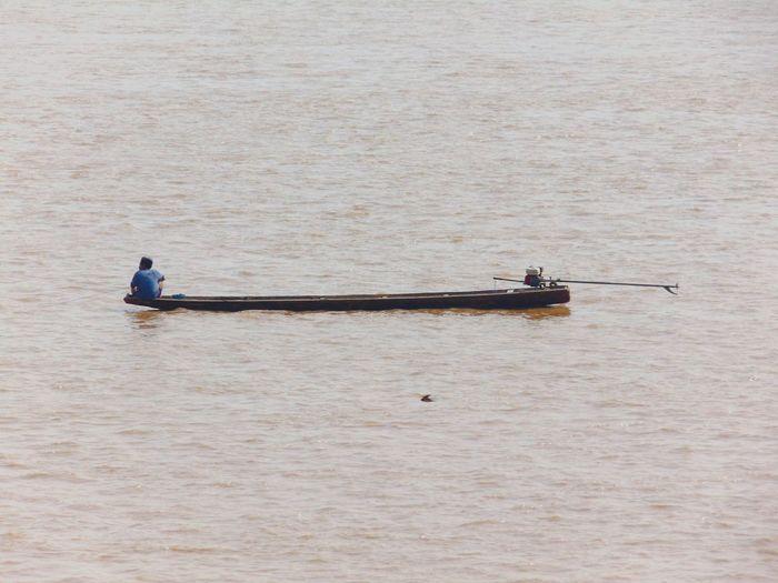 Man on boat in river