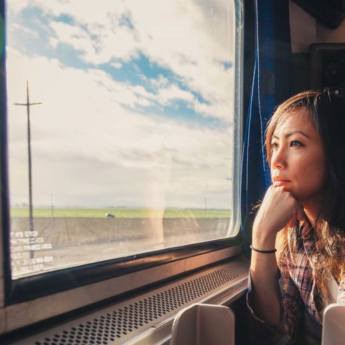 Woman looking through train window