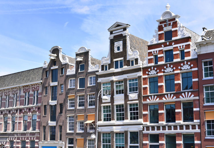 Old town houses in Amsterdam, dutch houses. Amsterdam Amsterdam Canal Houses Amsterdamcity Apartment Architecture Building Building Exterior Building Exteriors Built Structure City Day Facades House Facades In A Row Low Angle View Nature No People Old Houses Outdoors Residential District Sky Sunlight Town Houses Window