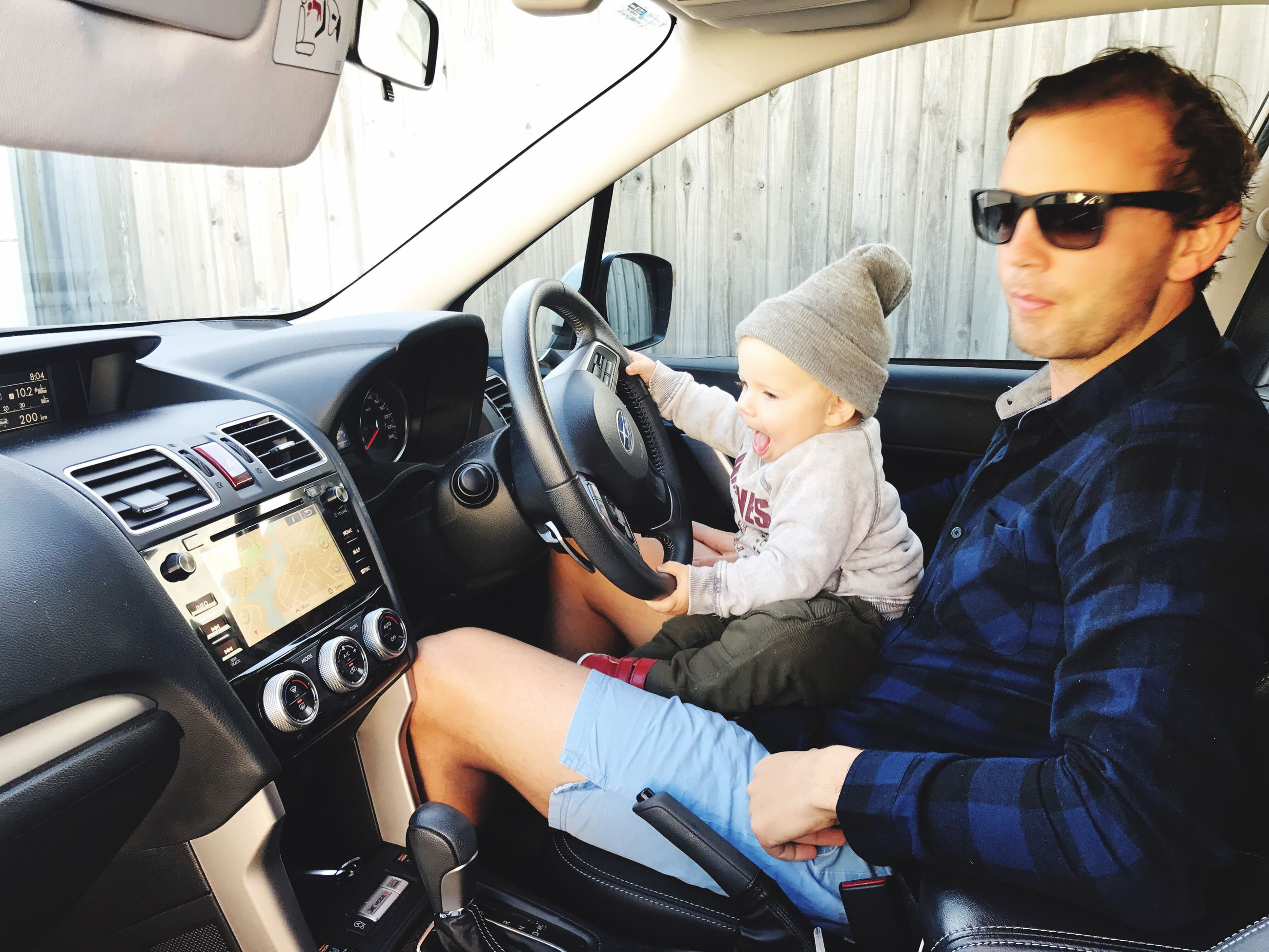 real people, sunglasses, mid adult men, mid adult, togetherness, car, elementary age, childhood, family with one child, lifestyles, leisure activity, boys, day, sitting, casual clothing, transportation, father, land vehicle, bonding, indoors, young adult