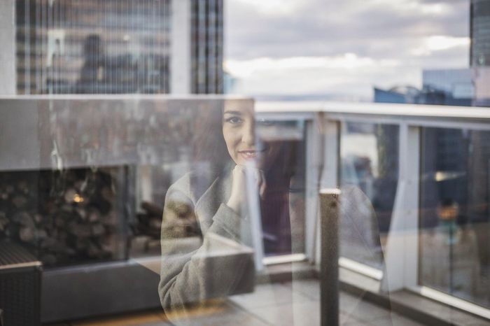 Through the Glass Glass - Material Window Reflection Transparent One Person Real People Leisure Activity Young Adult Looking Through Window Women Day Building Exterior Built Structure Young Women Indoors  City Sky Store Window Architecture Adult