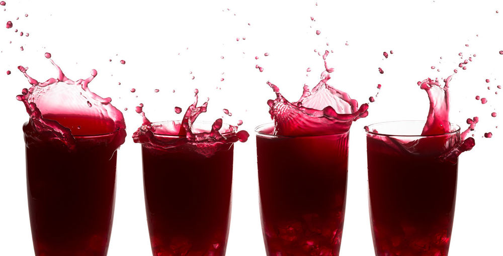 Sequence of splashes on raspberry juice against a white background Celebration Juice Liquid Red Action Drink Drinking Glass Food Motion Raspberry Juice Sequenced Series Spill Splash Splashing