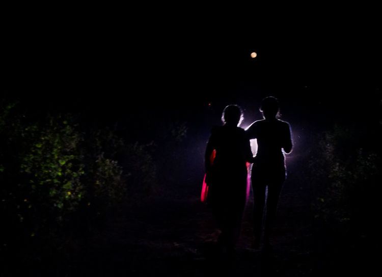 Beauty In Darkness Carlight Combination Dark Darkness And Light EyeEm Full Length Fullmoon Human Figure Human Vs Nature Light Play Moonlight Nature Walk Night Outdoors People Prospective Silhouette Sky Technology Vs Nature Togetherness Two People Village Life Walking In The Woods