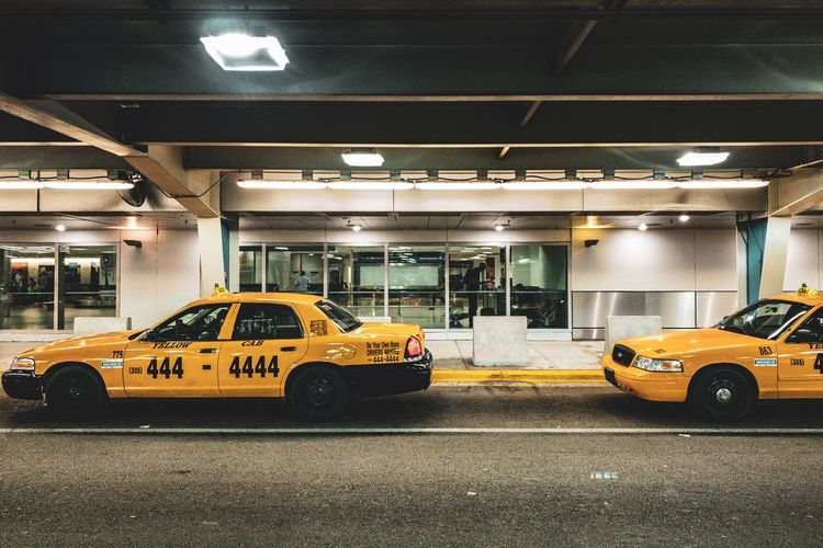 Taxi pls Miami, FL Miami Cab Taxi CFPRS Transportation Car Mode Of Transportation Motor Vehicle Architecture Land Vehicle Illuminated Yellow Taxi Yellow Taxi No People Built Structure Public Transportation Parking Lot Road City