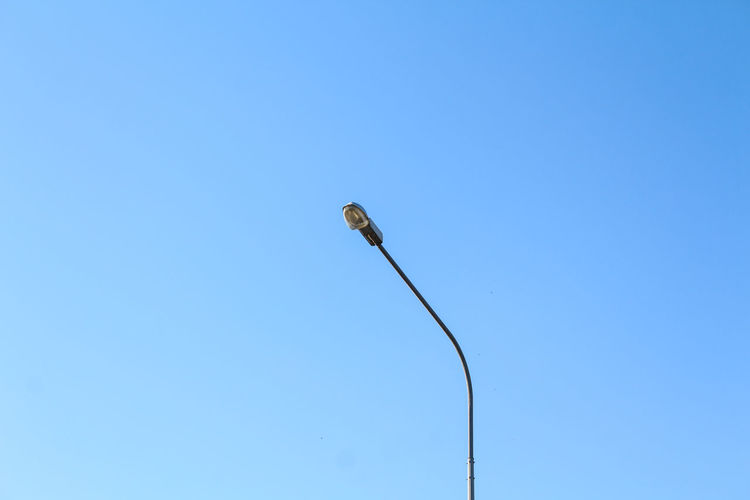 Blue Blue Sky Clear Sky Day Daylight Lamp Lamp Post Lamppost Minimal Minimalism Minimalist No Edits No Filters No Effects No Filter No Filter, No Edit, Just Photography No Filters Or Effects One Person Pillar Sky Street Light Street Photography Streetlights The Week On EyeEm