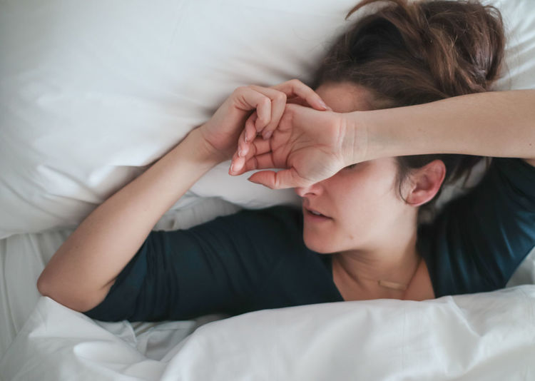 Directly above shot of woman sleeping in bed