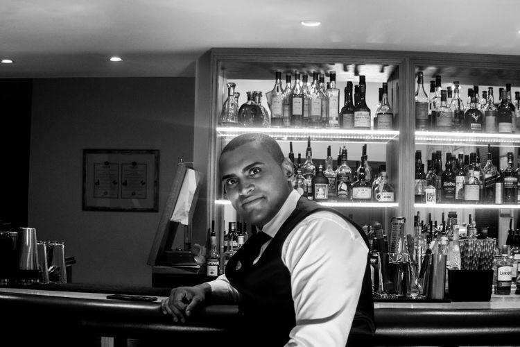 Portrait of smiling businessman sitting in bar