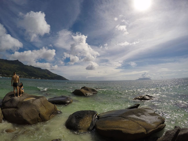 Cloud - Sky Outdoors Sky Landscape Nature Day Water No People Scenics SeaTourism Beauty In Nature People Couple Berjaya Beach Seychelles Tropical Climate Travel Destinations Aesthetic Adventure Couple Goals Rocks And Water Tropical Paradise Exploration Vacation Love