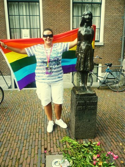 Rainbow Flag next to Anne Frank Statue in Amsterdam Lgbt Lesbian Lesbiansofinstagram Amsterdam Pride Flag Rainbow Flag Amsterdam Pride Anne Frank Statue This Is Queer Full Length Water Front View Sunglasses Building Posing Residential Structure Canal TOWNSCAPE Urban Scene Shorts Adventures In The City