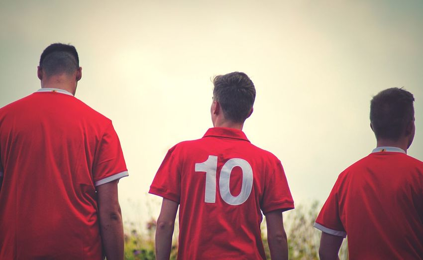 Football fans Rear View Group Of People Real People Men Red People Clothing Casual Clothing Sport Togetherness Standing Sky Soccer Uniform Sports Uniform Leisure Activity Lifestyles