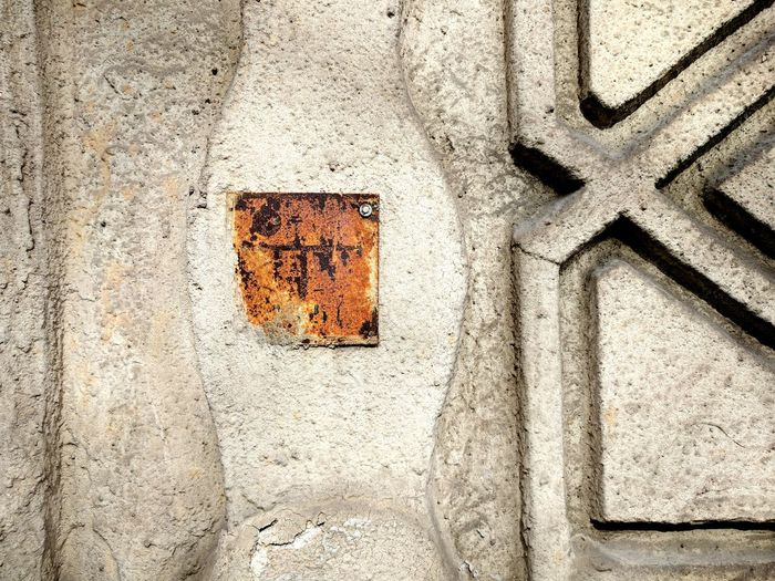 Time stop Pattern No People Full Frame Close-up Abstract Sign Plate Mark On Wall Metal Plate Architectural Detail
