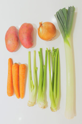 High angle view of vegetables on white background