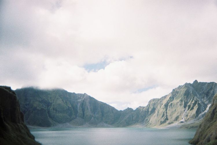 Beauty In Nature Cloud - Sky Day Environment Idyllic Lake Mountain Mountain Peak Mountain Range Mt. Pinatubo Nature No People Non-urban Scene Outdoors Pinatubo Pinatubocraterlake Scenics - Nature Sky Tranquil Scene Tranquility Water Waterfront