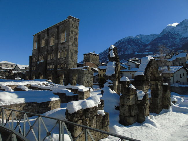 Aosta Architecture Beauty In Nature Blue Building Exterior Built Structure Clear Sky Cold Temperature Day Frozen Mountain Mountain Range Nature No People Outdoors Scenics Sky Snow Sunlight Travel Destinations Winter
