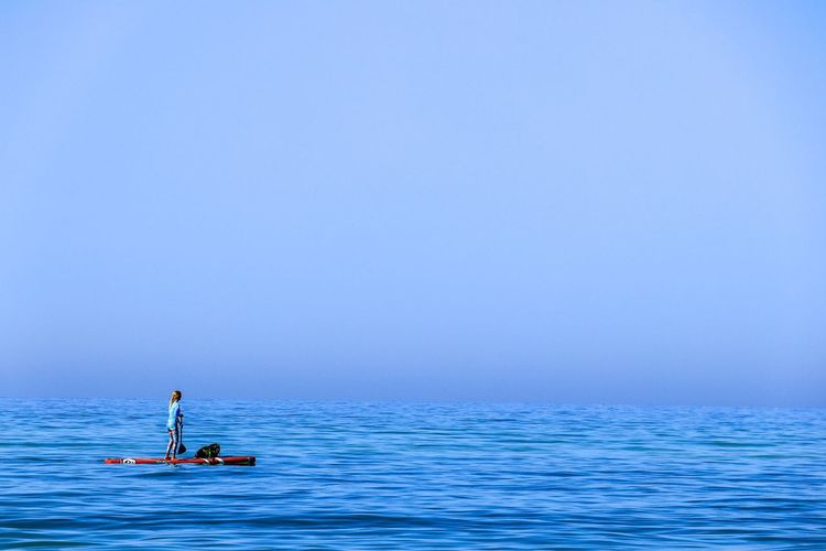 Water Sea Blue Nautical Vessel One Person Transportation Leisure Activity Sport Holiday Sky Trip Vacations Oar Adventure Copy Space Horizon Nature Horizon Over Water Paddling Outdoors