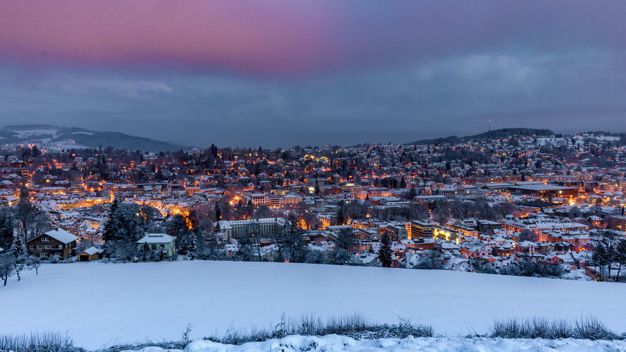 Illuminated City Against Sky During Winter