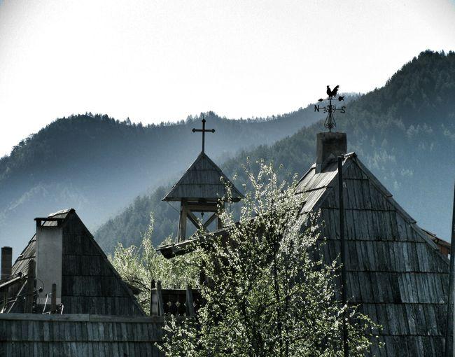 Church in village against mountains