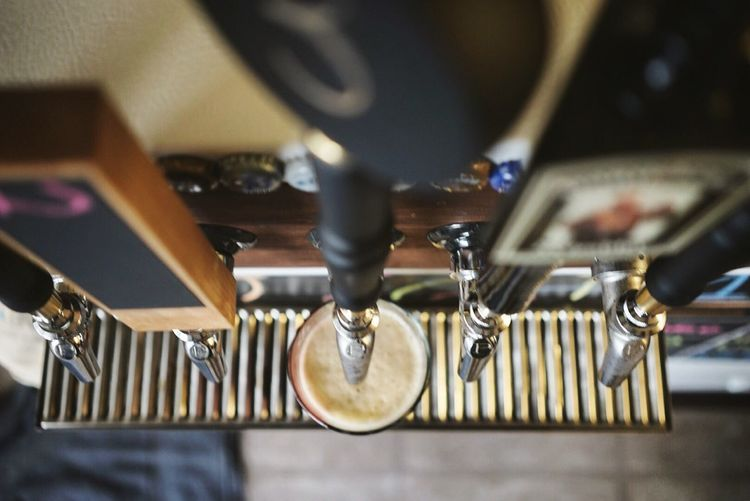 High angle view of brewery beer tap at bar