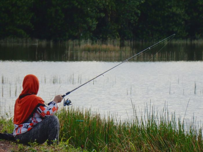 Woman Fishing In Lake