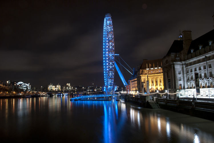 London Eye Nightphotography Night Lights Thames River River Peaceful Blue City Cityscape Urban Skyline Premiere Illuminated Ferris Wheel Nightlife City Life Bridge - Man Made Structure Business Finance And Industry Entertainment Light Trail Long Exposure