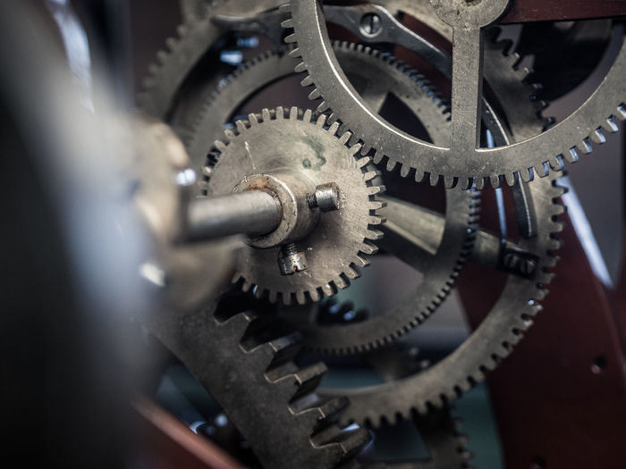 Clockwork Gears Accuracy Antique Clock Clockworks Close-up Complexity Equipment Factory Gear Indoors  Machine Part Machinery Manufacturing Metal No People Quality Control Selective Focus Silver Colored Technology Time Wheel