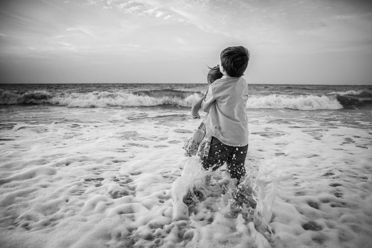 Ankle Deep In Water Beach Beauty In Nature Day Full Length Horizon Over Water Kids Lifestyles Nature One Person Outdoors People Real People Sand Scenics Sea Siblings Sky Standing Water Wave