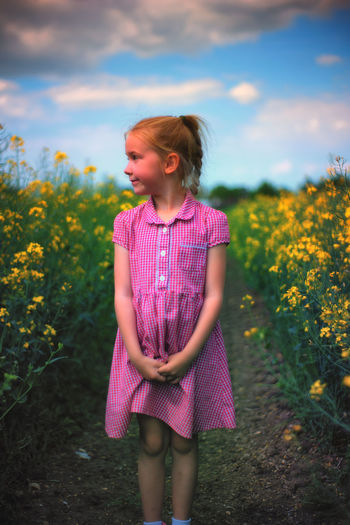 Beauty In Nature Childhood Day Field Flower Front View Girls Leisure Activity Nature One Person Outdoors Real People Sky Standing