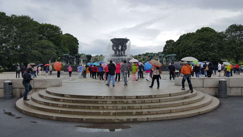 """Frogner Park (Norwegian: Frognerparken) is a public park located in the borough of Frogner in Oslo, Norway, and is historically part of Frogner Manor. The manor house is located in the south of the park, and houses the Oslo City Museum. Both the park, the entire borough of Frogner as well as Frognerseteren derive their names from Frogner Manor. Frogner Park contains, in its present centre, the world famous Vigeland installation (Norwegian: Vigelandsanlegget; originally called the Tørtberg installation), a permanent sculpture installation created by Gustav Vigeland between the 1920s and 1943. Although sometimes incorrectly referred to in English as the """"Vigeland (Sculpture) Park,"""" the Vigeland installation is not a separate park, but the name of the sculptures within Frogner Park. The sculpture park consists of sculptures as well as larger structures such as bridges and fountains. The park of Frogner Manor was historically smaller and centered on the manor house, and was landscaped as a baroque park in the 18th century by its owner, the noted military officer Hans Jacob Scheel. It was landscaped as a romantic park in the 19th century by then-owner, German-born industrialist Benjamin Wegner. Large parts of the estate were sold to give room for city expansion in the 19th century, and the remaining estate was bought by Christiania municipality in 1896 and made into a public park. It was the site of the 1914 Jubilee Exhibition, and Vigeland's sculpture arrangement was constructed from the 1920s. In addition to the sculpture park, the manor house and a nearby pavilion, the park also contains Frognerbadet (the Frogner Baths) and Frogner Stadium. The Frogner Pond is found in the centre of the park. Frogner Park is the largest park in the city and covers 45 hectares; the sculpture installation is the world's largest sculpture park made by a single artist. Frogner Park is the most popular tourist attraction of Norway, with between 1 and 2 million visitors each year, and is op"""