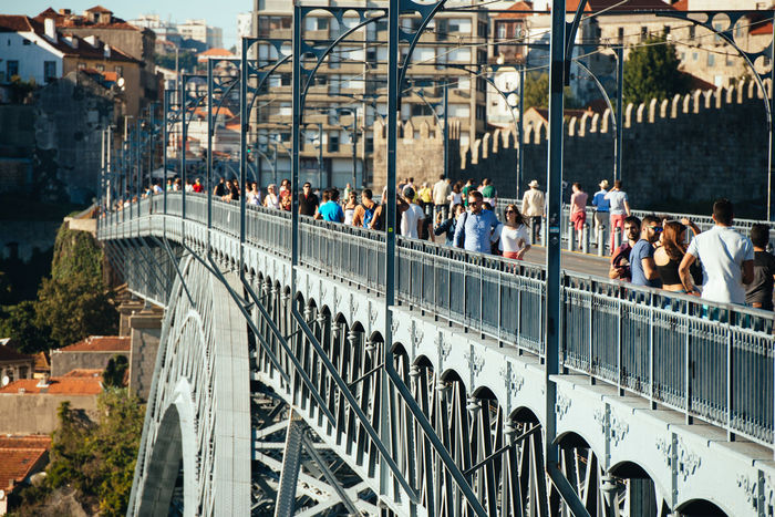 Architecture Bridge - Man Made Structure Built Structure City City Life Connection Day Douro  Holiday Large Group Of People Metal Oporto Outdoors People Ponte Porto Portugal Real People River Tourism Travel Travel Destinations Vacations Vila Nova De Gaia Walking