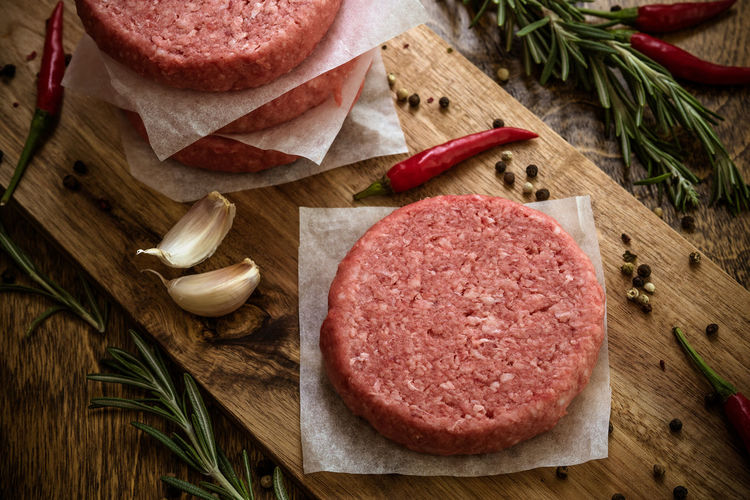 High Angle View Of Minced Meat With Ingredients On Cutting Board
