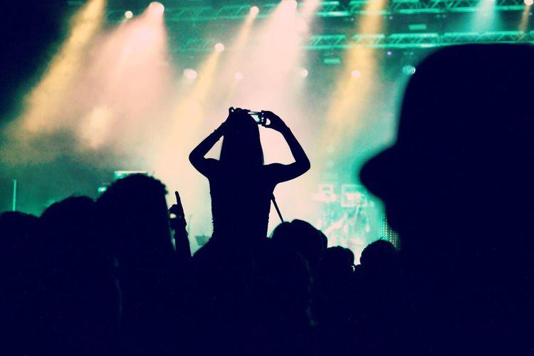 Silhouette of people in nightclub