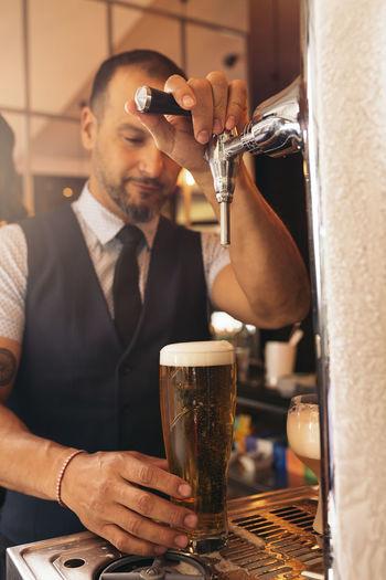 Waiter at bar