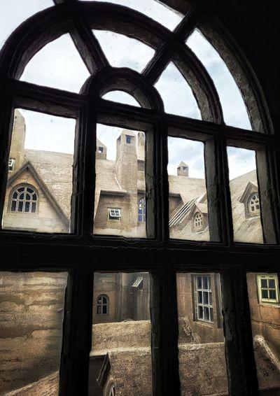 Old building seen through window