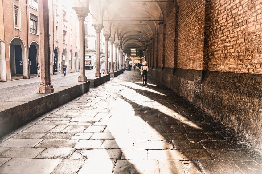 In love with Italian cities Traveling Itlay Architecture_collection Architecturelovers Fujifilm Italiancity Shadow Full Length Sunlight City Walking Men Architecture vanishing point Diminishing Perspective Passageway Colonnade Passage Archway Arcade Focus On Shadow The Way Forward Empty Road Historic Building